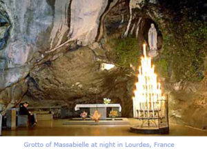 Grotto of Massabielle at night in Lourdes, France